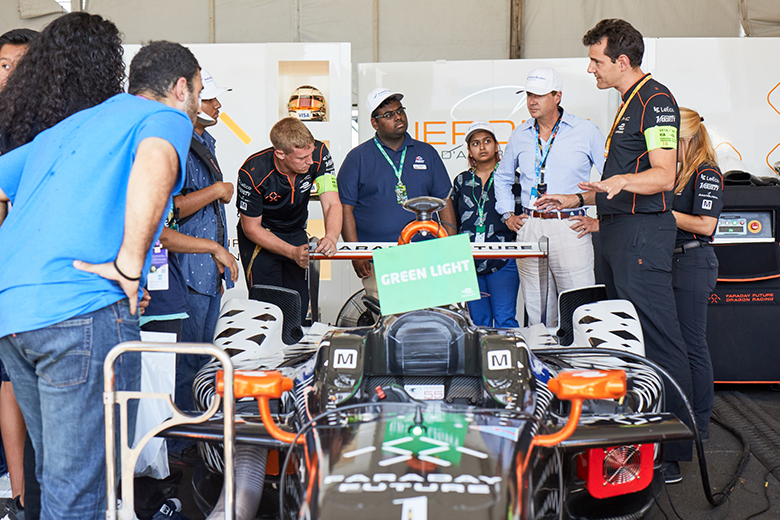 Argo's Mark Watson and young professionals at Formula E site