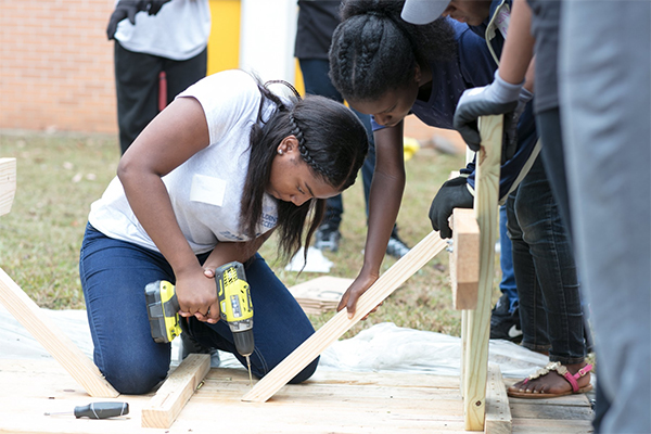 Amber Whitehead helps build a picnic table for Hands On Atlanta Day